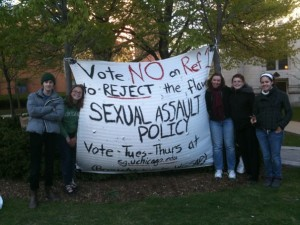 "WGSAPers next to a referendum banner in 2010.  The referendum.  72% of students answered ""NO"" when asked ""Should faculty from a student's own unit sit on the disciplinary hearing board of a sexual assault case involving that student (as is currently the policy)?"""